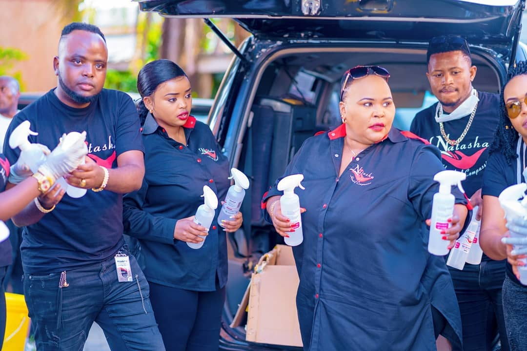 Popular female preacher on the spot for donating branded sanitizers and handwashing tap buckets